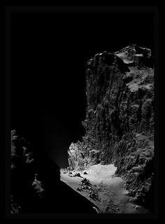 Gigantic cosmic cliff: Composed from four separate photos taken by Rosetta's NAVCAM from approximately 12 miles away, amateur astronomer Stuart Atkinson's crop work focuses our attention on the rugged cliff face, the boulders at the foot of which are approximately the length of an articulated (60ft) bus. CREDIT: ESA/Rosetta/NAVCAM – CC BY-SA 3.0 IGO (https://creativecommons.org/licenses/by-sa/3.0/igo/) Additional Processing: Stuart Atkinson