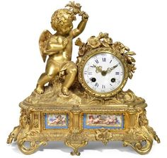 A French gilt bronze and porcelain inset mantel clock