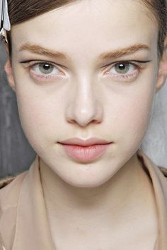 Floating cat-eye: On bare lids, use a liquid liner to draw a line in your crease. Follow the contour of your eye and wing out at the outer corners.