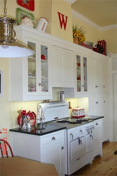 Cheery Cherry Kitchen Love the Red Letter W! hee hee Also love the silver lamp/swag/chandelier. Kitchen Cabinets Decor, Farmhouse Kitchen Cabinets, Cottage Kitchens, Kitchen Dinning, Kitchen Cabinet Design, Kitchen Redo, Home Kitchens, Kitchen Remodel, Kitchen Ideas