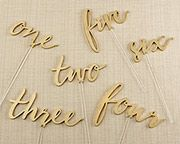 Decorative in a gold calligraphy print, Kate Aspen's Gold Calligraphy Wedding Table Numbers are perfect for your wedding, anniversary party, or other special event.