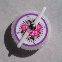 SWAPS compass made with the tines of a plastic fork as the movable needle attached to a plastic water bottle lid. Kid's craft.