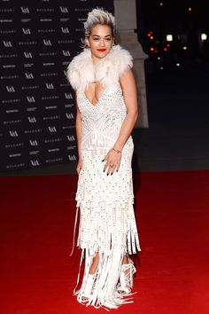 Okay, okay, Rita Ora's strip-fringed, leather Roberto Cavalli dress is a whole lot of look. The takeaway? Think boldly. A standout piece, like a fringed-back blouse, will be just as eye-catching for any number of summer fetes (because you might not be walking any red carpets).