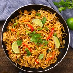 The easiest, most unbelievably delicious Chicken Pad Thai is full of authentic favors and so much better than take outs. And it'll be on your dinner table in just 20 minutes. One of the best Asian dinner ideas! A perfect easy weeknight meal. Quick and easy dinner recipe. Video recipe. | Tipbuzz.com #PadThai #ChickenPadThai