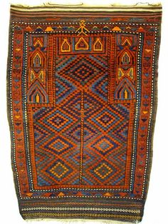 unusual belouch prayer rug. i think this piece is from the region of Andraskand. It is in excellent condition with original sides and long kelim ends. It appears to have a portrayal of a man above the niche in the top border. Reference 1592. 134 x 95cms. €390.