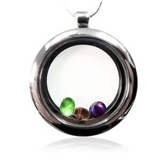 Circle glass locket necklace with family birthstones inside.
