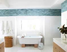 Accent tile above white A Tranquil Beach Inspired Bathroom House Beautiful