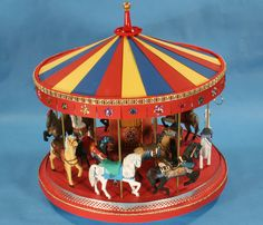 @Lynnette Nankervis .... Miniature Carousel! Built from scratch using a foamcore sctructure. All horses hand-carved from balsa wood.