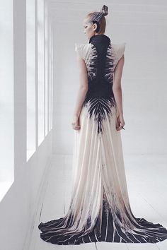 Octave 9 back. Black amd off white or ivory. Spine design on the back of the dress. Modern and futuristic floor-length gown.