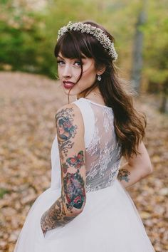 Bride with sleeve tattoo and flower crown @myweddingdotcom