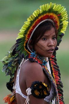 """""""Brazil: A young Rikbakisa Indian woman at the Indigenous Games on the island of Porto Real in the city of Porto Nacional. © Eraldo Peres for AP.""""  The Rikbaktsa are an indigenous ethnic group from the Mato Grosso region of Brazil."""