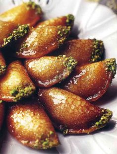 Atayef – Stuffed Syrian Pancakes 'Ataiyef is not your ordinary Sunday morning pancake. Filled with ricotta cheese, deep-fried, dipped in chopped pistachio nuts, and topped with shira (Fragrant Aleppian Dessert Syrup), it is more like a five-star dessert. Aleppian Jews eat 'ataiyef on happy occasions such as engagement parties.