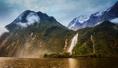 This is Bowen Falls in Milford Sound, and right at the bottom is a very old grave that you can hike to. It's not an easy hike, but you can get there if you are crafty. It's the grave of William Ward Rathbun, and there is an old iron fence that is falling apart around it. It's all very scenic and grave-y. - Milford Sound, New Zealand - Photo from #treyratcliff Trey Ratcliff at http://www.StuckInCustoms.com