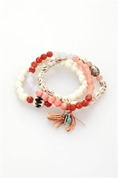 Chan Luu's stretch bracelets. Pretty beachy colors! Makes me want summer back.
