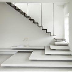 A smoked-oak staircase suspended from steel poles joins a flight of tapered terrazzo steps in this Copenhagen apartment, which has been overhauled by local practice jacstudios. Oak Stairs, Concrete Stairs, House Stairs, Stair Handrail, Staircase Railings, Stairways, Architecture Design, Stairs Architecture, Interior Staircase
