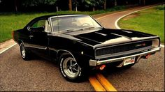 """One of my all-time faves: a TX9 black 1968 Dodge Charger R/T with a red bumblebee stripe and factory Magnum """"road wheels."""""""