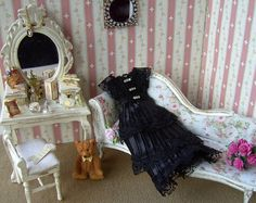 Pauline Whiteley of Etsy shop Buyminiart sells 1:12 scale dollhouse clothes and other items.