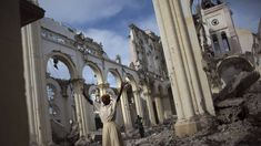 A woman prays amid the rubble of the damaged main cathedral in downtown Port-au-Prince, the capital of Haiti, in January 2011, as the country marked the first anniversary of the January 12 earthquake that killed around 250,000 people and wrecked much of Port-au-Prince. Photo: Reuters  http://www.evememorial.org/index.html