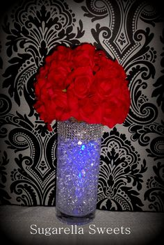 This LED light centerpiece tutorial will make your table look amazing. All you need is a clear vase, water beads, LED lights and some synthetic flowers. This...