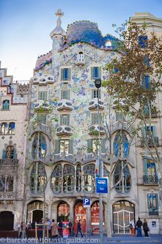 """Casa Batlló Façade is a stunning beautiful Gaudí creation. Casa Batlló is one of the two great buildings designed by Antoni Gaudí on Passeig de Gràcia, the other being La Pedrera. From the outside the façade of Casa Batlló looks like it has been made from skulls and bones. The """"Skulls"""" are in fact balconies and the """"bones"""" are supporting pillars."""