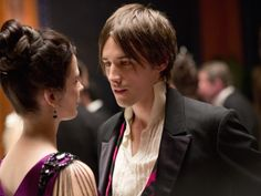 Reeve Carney as Dorian Gray, an aesthete, dressed somewhat alike the romantically attired author who created him.