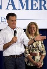 Republican presidential candidate former Massachusetts Gov. Mitt Romney, left, addresses an audience as his wife Ann looks on during a campaign stop Sunday in Moline, Ill.