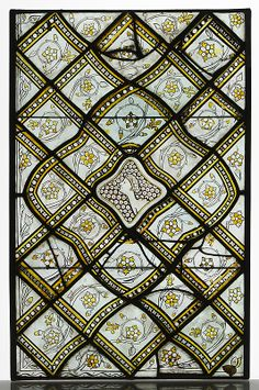 Grisaille Panel with Grotesques, ca 1320-24 French stained glass.  I don't see anything grotesque unless it is that guy in the center and he doesn't look all that bad.