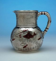 Tiffany sterling and mixed metal pitcher, with applied fish and an engraved dragonfly, c1874
