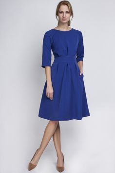Reminiscent of Duchess Kate's blue engagement dress, this A-line dress works great at the office and at social events. Knee-length with an easy back zipper closure and a fitted waistline for a feminin