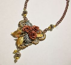 Mixed Metals Challenge necklace from the Tre Rose line at Novegatti Designs.   Copper polyclay roses, with various finishes of B'sue filigree nd leaves.  www.facebook.com/NovegattiDesigns