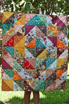 Squares, made of triangles make a quilt. Simple. ive been looking for a quilt pattern to make one out of my daughters dresses as she gets older i have been saving the special on every year and i love this pattern