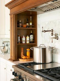 Sleek Storage-The custom-built hearth over the commercial-style range is complete with storage shelves to keep oils, spices, and other cooking necessities handy. The hearth also conceals a powerful vent and recessed lighting
