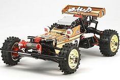 The Tamiya R/C Hotshot 2007 - Metallic Special Model Kit in 1/10 scale is a radio control car from the tamiya rc off road collection.    This is a Limited Edition assembly kit of the Hot Shot. The standard Hot Shot was re-introduced in 2007 featuring up to date parts while remaining faithful to the original. The limited edition features a special gold plated body, rear wing and wheels to commemorate the 35 years that Tamiya has been making R/C kit products.