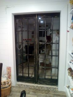 Two French doors made in to a sliding barn door!! Detressed it and put on hook and eyes to hold it together!!! Used black pipe to slide in on with wheels on bottom!! Closes over coat closet then they slide all the way down to the kitchen if you want to block off kitchen
