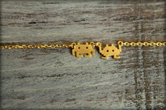 cool geeky jewelry: 8-bit Space Invaders necklace