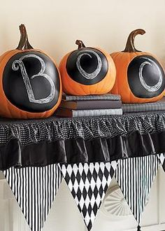 """Set a festive Halloween scene with the Chalkboard Pumpkin; detailed and realistic pumpkins with chalkboard """"faces"""" for haunting customization."""