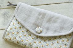 Clutch with inside zipped section and card slots.  Link to PDF tutorial.