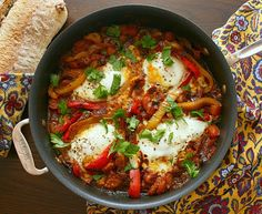 Shakshuka is a hearty dish of eggs poached in a spicy tomato sauce. Serve it with some olive bread to soak up all the goodness! by kelseysappleaday as adapted from Yotam Ottolenghi #Shakshuka #Eggs #Tomato #kelseysappleaday