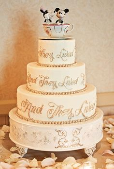 disney inspired wedding cake.. And they lived happily ever after .. I'd prefer the Disney Cinderella on top