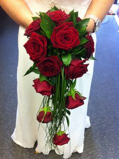 Exquisite Red Rose Shower Bouquet complimented with bear grass