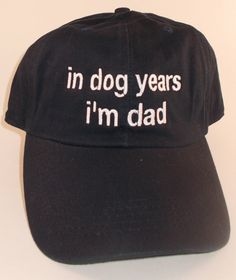 This Fun hat would be a great conversation piece. This comfortable soft style, unstructured hat is sure to catch someones attention!!! Picture 1- Shows Black hat with white words and reads: in dog years im dad Picture 2- Shows stone hat with black words Picture 3- Shows Pink hat with white words Picture 2- Hat available in Black, pink, or stone ALSO AVAILABLE in NAVY Pro Style. Prewashed unconstructed soft crown(six panels). One size fits most. Size adjustable by rear self-fabric strap…