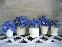 This would look great down the center of a table! Blue Hydrangeas in white vases!