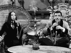 The Addams Family Gomez and Morticia Addams Smoking Hookah- this is awesome ^-^ Morticia Addams, Gomez And Morticia, The Addams Family 1964, Addams Family Tv Show, Adam Meme, Los Addams, Charles Addams, Carolyn Jones, The Munsters
