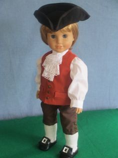 Custom-designed Colonial Boy doll outfit - tricorn hat, blouse, waistcoat, breeches, thigh-high knitted stockings, shoes.  Sold on etsy.