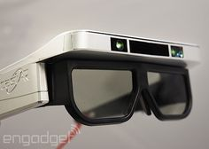 "Features include active shutter glasses, a camera for input and a projector that displays 3D images onto a surface. Its developers call the device ""the most versatile AR and VR system,"" but its strength lies in augmented reality (digital display superimposed against the real word)."