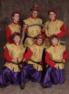Guards purple harem pants, gold tunic w/red sleeves & collar, hat - Dance number?