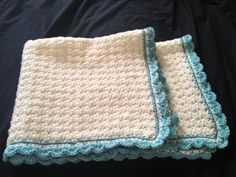 White with blue border soft crochet baby blanket