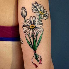Daisy chains and plucked petals are the order of the day in this list of super cute #daisy #tattoos!