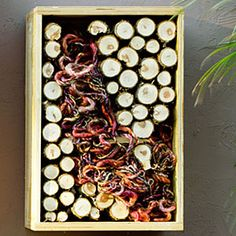 8 stylish bug hotels | Yarn   Strands of yarn draw birds, which take them to line their nests (you'll want to replenish the materials as needed). Stacked sticks house beetles and spiders, which keep mosquitoes and flies in check.