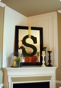 another great mantle idea!  easy to change out the centerpiece. I have the mirror and the R, just need some ribbon.